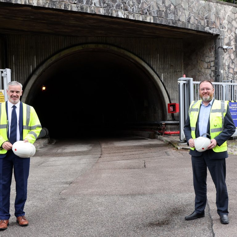Drax Group's Ian Kinnaird (L) with UK Government Minister for Scotland, David Duguid (R), at the mouth to the access tunnel to Cruachan Power Station which stretches 1km into the heart of Ben Cruachan.